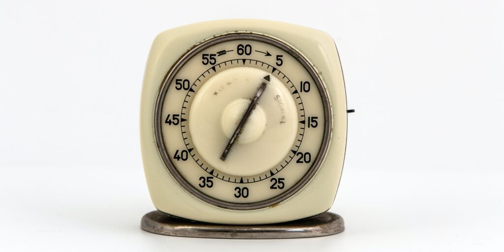 a white, old school kitchen timer to learn how to cook wagyu beef