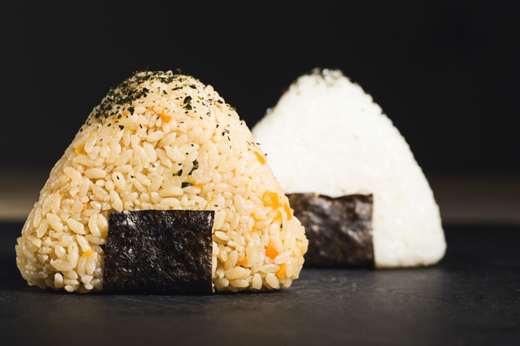 rice cooked and fashioned into triangles with seasonings. Serve as side dish to wagyu beef