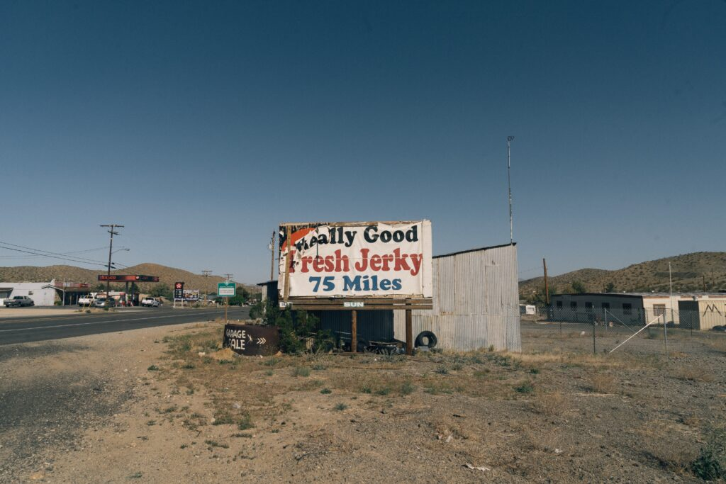 A run down sign promoting fresh beef jerky in a rural part