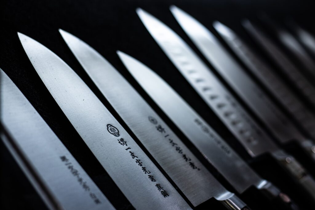 You need proper tools if you are wondering about how to cook wagyu beef on grill. This picture shows japanese straight edge knives