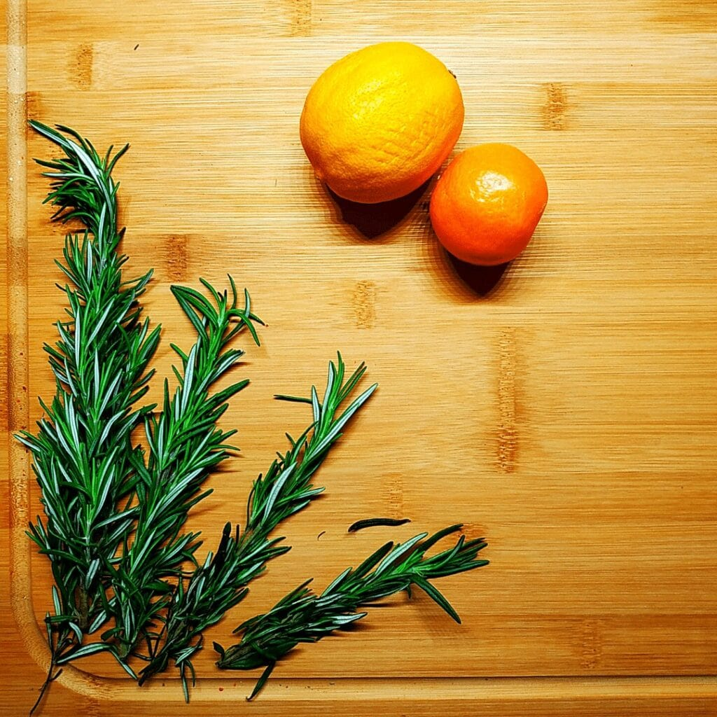 #12 of most popular spices is whole sprigs of Rosemary pictured here on a cutting board