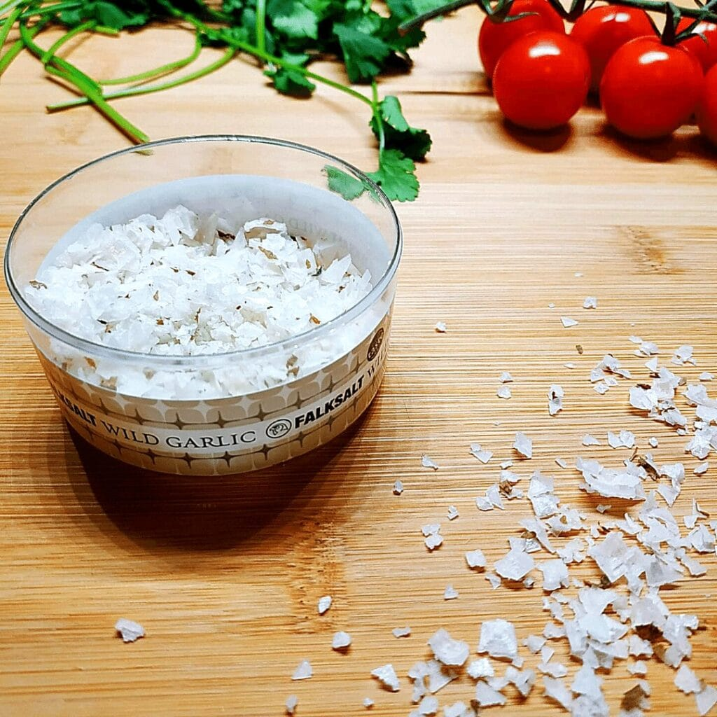 seasoned salt can be made with whatever you want. this image is wild garlic seasoned salt flakes