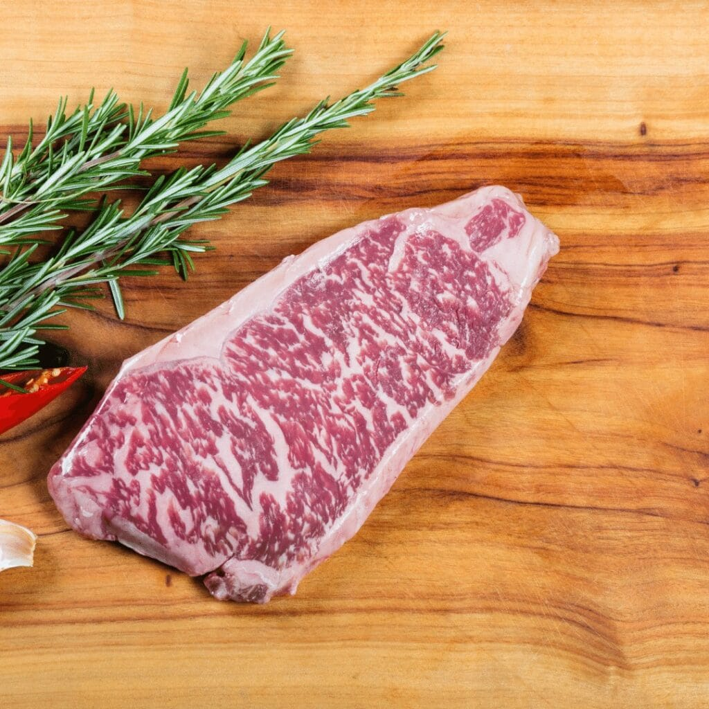 A slice of wagyu steak with marbling. Tips on how to cook wagyu on grill