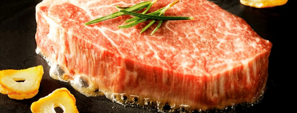 How Long Should I Cook Wagyu Steak intro image featuring a sizzling piece of steak